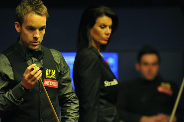 Ali Carter of England (L) prepares to play a shot during the second session of the World Championship Snooker final against Ronnie O'Sullivan of England Ali Carter of England at the Crucible Theatre in Sheffield, on May 7, 2012. AFP PHOTO/PAUL ELLISPAUL ELLIS/AFP/GettyImages