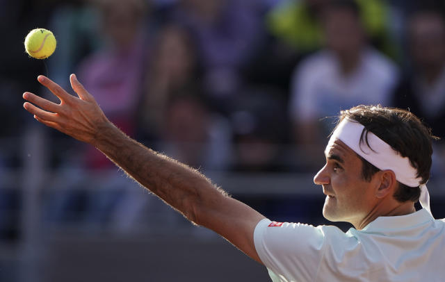 Roger Federer of Switzerland serves the ball to Borna Cedric of Croatia at the Italian Open tennis tournament, in Rome, Thursday, May 16, 2019. (AP Photo/Andrew Medichini)