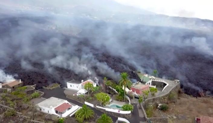 In this image made from video provided by OVERON, lava is seen after a volcanic eruption in La Palma, Spain, Monday, Sept. 20, 2021. Giant rivers of lava are tumbling slowly but relentlessly toward the sea after a volcano erupted on a Spanish island off northwest Africa. The lava is destroying everything in its path Monday, but prompt evacuations helped avoid casualties after Sunday's eruption.
