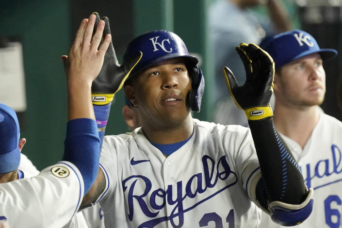 Kansas City Royals' Salvador Perez celebrates in the dugout after hitting a solo home run during the fifth inning of a baseball game against the Oakland Athletics Wednesday, Sept. 15, 2021, in Kansas City, Mo. (AP Photo/Charlie Riedel)