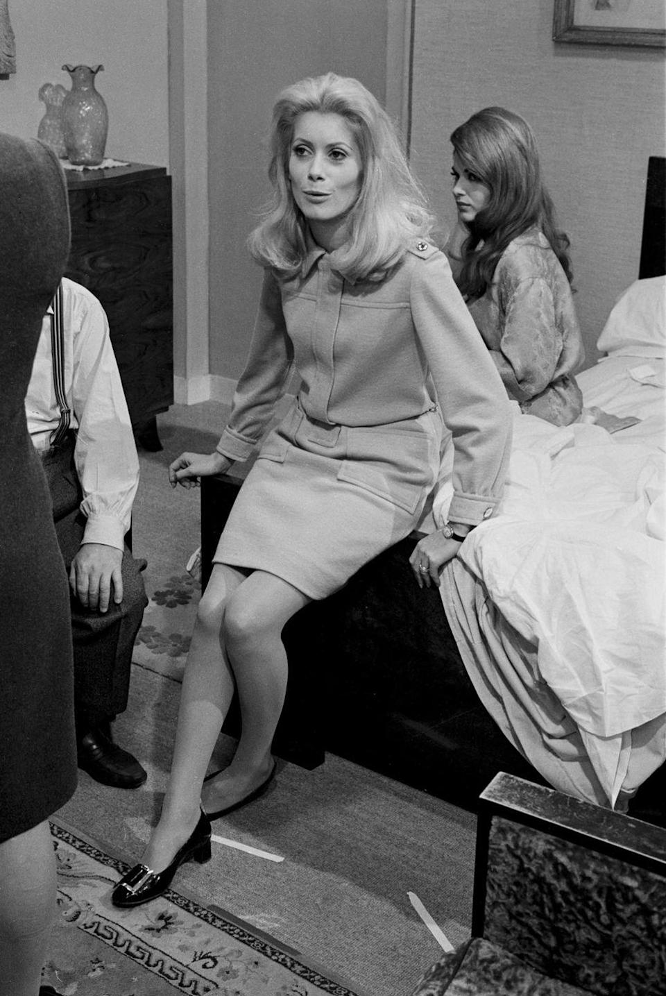 """<p>Catherine Deneuve's patent leather Roger Vivier buckle shoes are so iconic, they were <a href=""""https://www.wsj.com/articles/back-by-popular-demand-the-shoes-catherine-deneuve-wore-in-belle-de-jour-1501782795"""" rel=""""nofollow noopener"""" target=""""_blank"""" data-ylk=""""slk:re-issued in 2017"""" class=""""link rapid-noclick-resp"""">re-issued in 2017</a> in honor of the movie's 50th anniversary.</p>"""