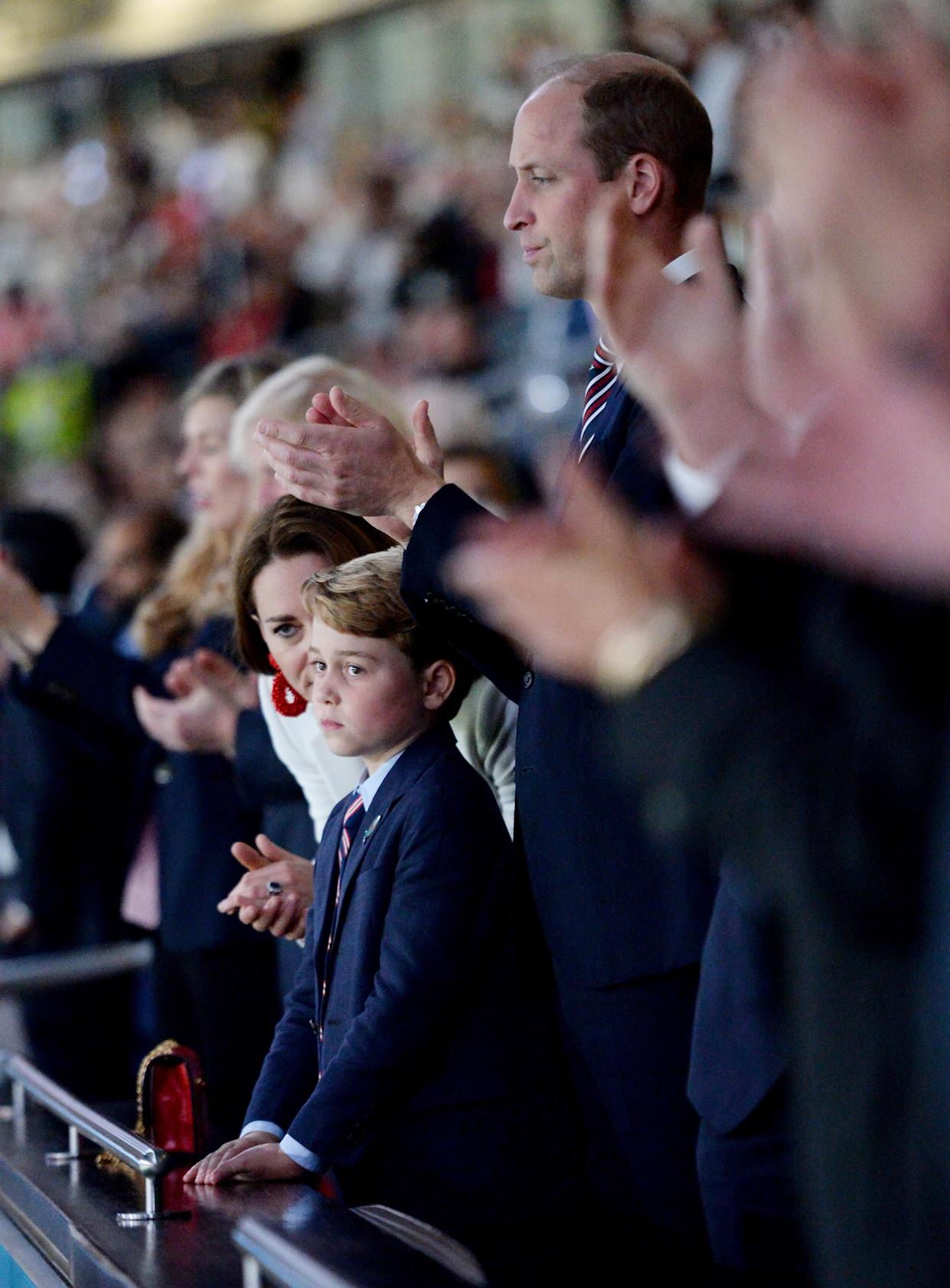LONDON, ENGLAND - JULY 11: Prince George of Cambridge, Catherine, Duchess of Cambridge, and Prince William, Duke of Cambridge and President of the Football Association (FA) are seen in the stands prior to the UEFA Euro 2020 Championship Final between Italy and England at Wembley Stadium on July 11, 2021 in London, England. (Photo by Eamonn McCormack - UEFA/UEFA via Getty Images)