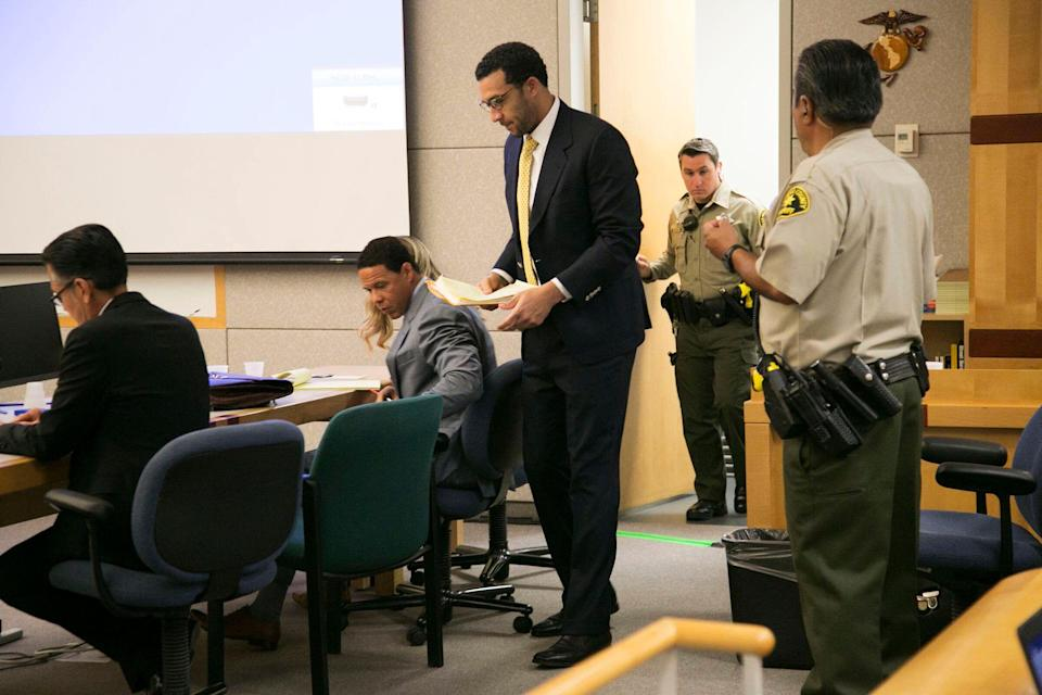 Kellen Winslow, standing, is accused of raping three women. He faces a potential life sentence if convicted. (AP)