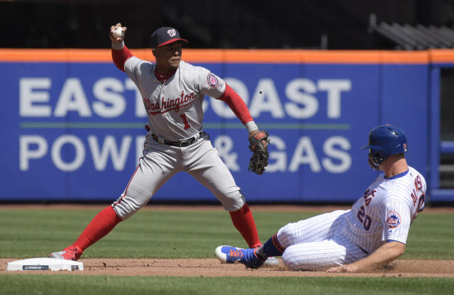 New York Mets runner Pete Alonso, right, is forced out at second base as Washington Nationals shortstop Wilmer Difo relays the ball to first to complete the double play on Mets' Robinson Cano during the first inning of a baseball game Thursday, April 4, 2019, in New York. (AP Photo/Bill Kostroun)