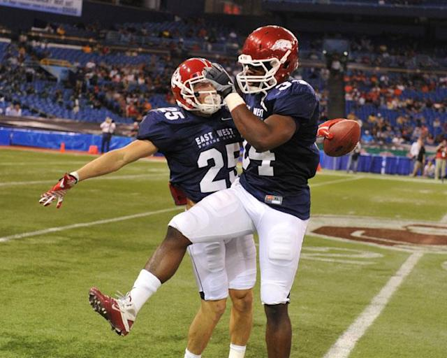 ST. PETERSBURG, FL - JANUARY 21: Wide receiver Devon Wylie #25 of the Fresno State University Bulldogs celebrates a kick return with linebacker Jerry Franklin #34 of the University of Arkansas Razorbacks during the 87th annual East-West Shrine game January 21, 2012 at Tropicana Field in St. Petersburg, Florida. (Photo by Al Messerschmidt/Getty Images)