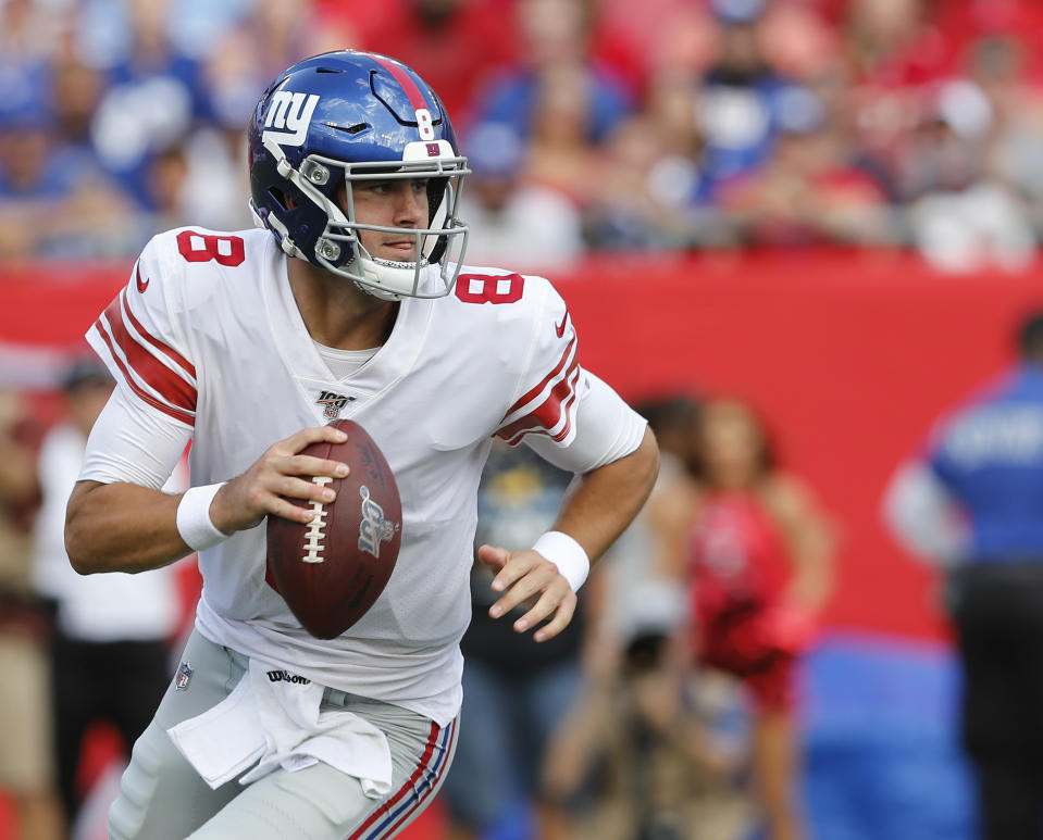 TAMPA, FLORIDA - SEPTEMBER 22: Quarterback Daniel Jones #8 of the New York Giants rolls out during the game against the Tampa Bay Buccaneers at Raymond James Stadium on September 22, 2019 in Tampa, Florida. (Photo by Mike Zarrilli/Getty Images)