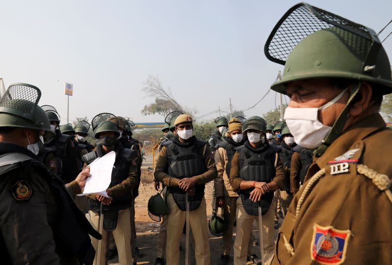 Security personnel wearing protective face masks are seen at the site of a protest against the newly passed farm bills at Singhu border near Delhi