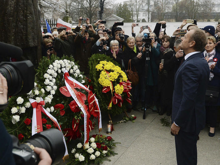 Donald Tusk, ex-Polish prime minister and president of the European Council, lays flowers at a statue of Marshal Jozef Pilsudski on the centenary of Polish independence in Warsaw, Poland, Sunday, Nov. 11, 2018. Pilsudski was the Polish leader who led Poland in regaining its lost statehood at the end of World War I after more than a century of rule by foreign powers. (AP Photo/Czarek Sokolowski)