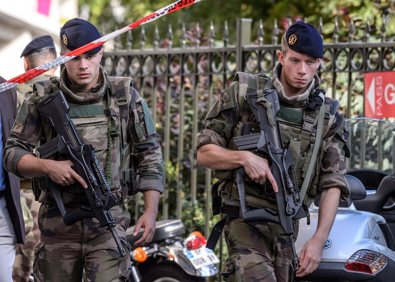 <p>Military officers set up a security perimeter near the site where six soldiers of the anti-terrorism Sentinelle operation were hit by a car in Levallois-Perret, near Paris, France, Aug. 9, 2017. (Photo: Christophe Petit Tesson/EPA/REX/Shutterstock) </p>