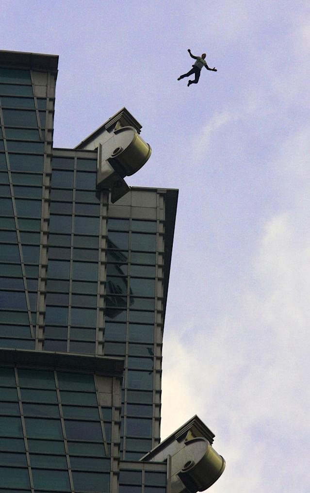 This image provided by the Euro-Newsroom agency shows Austrian base jumper Felix Baumgartner leaping off the Taipei 101 skyscraper in Taiwan Tuesday Dec. 11, 2007. Baumgartner leapt from the 1,676 foot (509 meters) tall building Tuesday after evading security and having to clear a barrier before being able to make his leap. (AP Photo/Bernhard Spoettel, Euro-Newsroom)