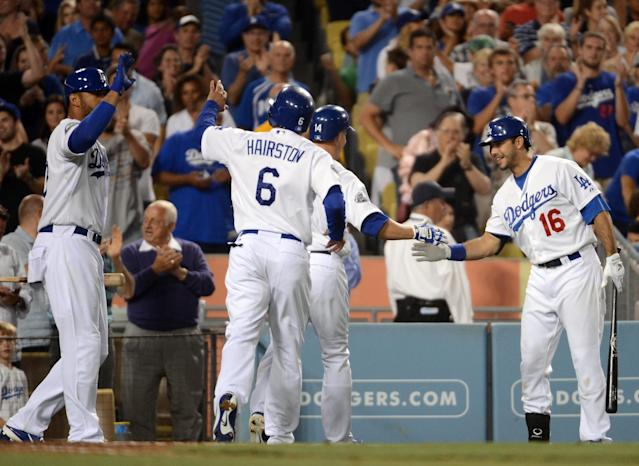 LOS ANGELES, CA - JULY 13: Andre Ethier #16 of the Los Angeles Dodgers reacts to a two run homerun by Mark Ellis #14 along with Jerry Hairston Jr. #6 and Matt Kemp #27 for a 2-1 lead over the San Diego Padres during the sixth inning at Dodger Stadium on July 13, 2012 in Los Angeles, California. (Photo by Harry How/Getty Images)