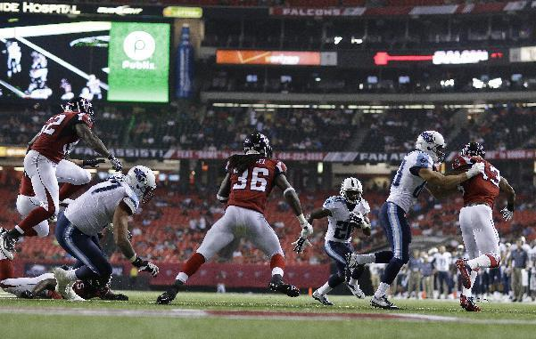 Tennessee Titans running back Bishop Sankey (20) runs against the Atlanta Falcons during the second half of an NFL preseason football game, Saturday, Aug. 23, 2014, in Atlanta. Sankey scored a touchdown on the play. (AP Photo/David Goldman)
