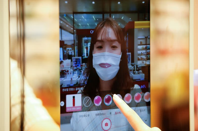 Through the looking glass: South Korean 'augmented reality' mirror allows touchless cosmetics shopping