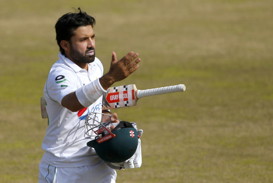 Pakistan's Mohammad Rizwan, who scored 115 not out, leaves the field at the end of the 2nd inning on the fourth day of the second cricket test match between Pakistan and South Africa at the Pindi Stadium in Rawalpindi, Pakistan, Sunday, Feb. 7, 2021. (AP Photo/Anjum Naveed)