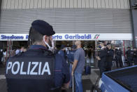 Police officers stand guard at Porta Garibaldi train station, in Milan, Italy, Wednesday, Sept. 2, 2021. Italy's government vowed to crack down on demonstrators threatening to block train tracks throughout the country Wednesday as a rule requiring COVID-19 tests or vaccines to use public transportation for long-distance domestic travel took effect. (AP Photo/Luca Bruno)
