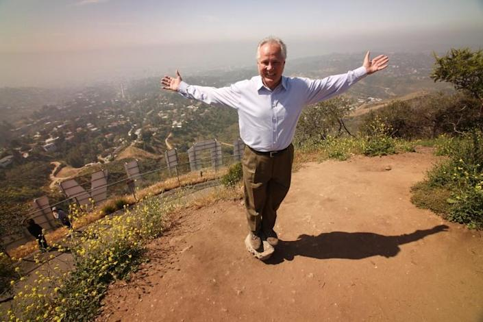 LOS ANGELES, CA - APRIL 26: Tom LaBonge died on January 7, 2021 at the age of 67. LaBonge was a member of the Los Angeles City Council representing the 4th district, serving from 2001 to 2015 and was a advocate for Griffith Park, one of the largest urban parks in the nation, which fell in his council district. On April, 26, 2010 Tom stands near the top of Mount Lee above the Hollywood Sign following a press conference to announce that a $900,000 donation from Hugh Hefner of Playboy Enterprises closed the gap on their Save the Peak campaign to buy 138 acres of hillside beside the famed Hollywood Sign from developers. Griffith Park on Monday, April 26, 2010 in Los Angeles, CA. (Al Seib / Los Angeles Times)