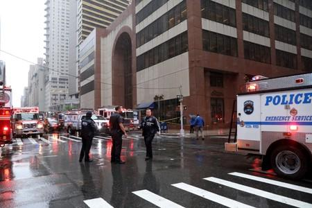 Emergency services first responders arrive at 787 7th Avenue in midtown Manhattan where helicopter crashed in New York