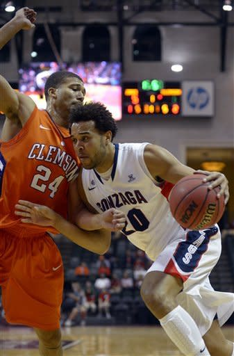 Gonzaga forward Elias Harris, right, drives past Clemson forward Milton Jenings (24) during the first half of an NCAA college basketball game at the Old Spice Classic in Kissimmee, Fla., Thursday, Nov. 22, 2012. (AP Photo/Phelan M. Ebenhack)