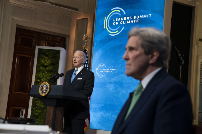 Special Presidential Envoy for Climate John Kerry listens as President Joe Biden speaks to the virtual Leaders Summit on Climate, from the East Room of the White House, Friday, April 23, 2021, in Washington. (AP Photo/Evan Vucci)