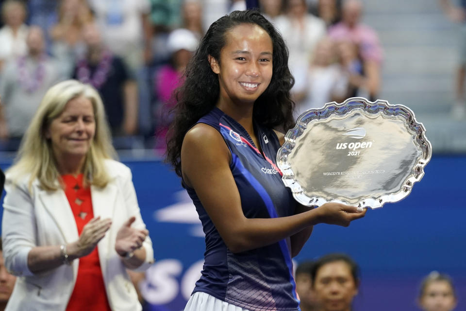 Leylah Fernandez, of Canada, holds up the runner-up trophy after losing to Emma Raducanu, of Britain, during the women's singles final of the US Open tennis championships, Saturday, Sept. 11, 2021, in New York. (AP Photo/Seth Wenig)
