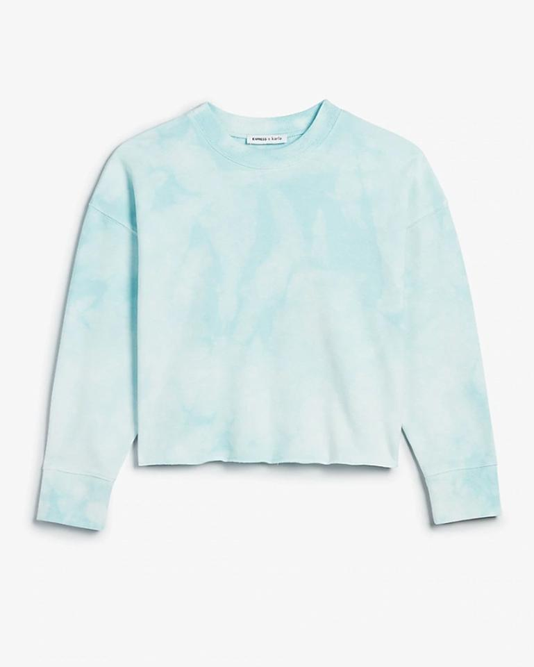 "$49.9, Express. <a href=""https://www.express.com/clothing/women/x-karla-tie-dye-cropped-crew-neck-sweatshirt/pro/06436022/color/Sky%20Blue/"">Get it now!</a>"