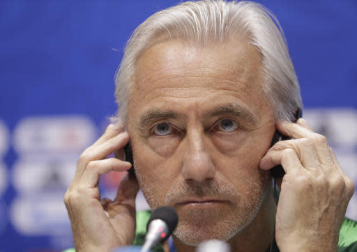 Australia head coach Bert van Marwijk listens to a question during the official press conference on the eve of the group C match between Peru and Australia at the 2018 soccer World Cup in the Fisht stadium, in Sochi, Russia, Monday, June 25, 2018. (AP Photo/Andre Penner)