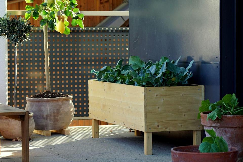 <p>You can never go wrong with a handmade wood design that's ideal for growing vegetables (think zucchini or radishes) right on your porch. </p>