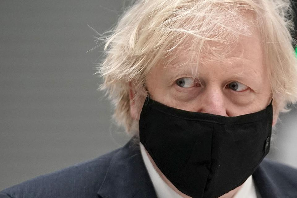 Britain's prime minister Boris Johnson wearing a mask because of the coronavirus pandemic visits BAE Systems at Warton Aerodrome in Preston, northwest England, on March 22, 2021. - The prime minister's visit comes to mark the publication of the UK government's Integrated Review, an overhaul of Britain's security, defence and foreign policy, billed as the biggest since the Cold War era. (Photo by Christopher Furlong / POOL / AFP) (Photo by CHRISTOPHER FURLONG/POOL/AFP via Getty Images)
