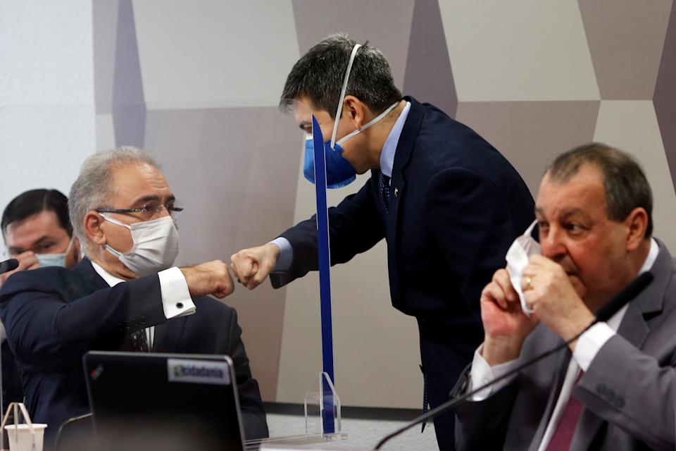 Brazil's Health Minister Marcelo Queiroga greets senator Randolfe Rodrigues during a meeting of the Parliamentary Inquiry Committee (CPI) to investigate government actions and management during the coronavirus disease (COVID-19) pandemic, at the Federal Senate in Brasilia, Brazil June 8, 2021. REUTERS/Adriano Machado