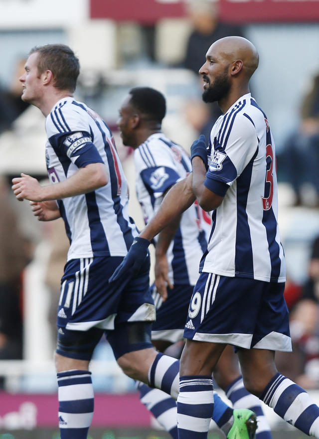 West Bromwich Albion's Nicolas Anelka, right, gestures as he celebrates his goal against West Ham United during their English Premier League soccer match at Upton Park, London, Saturday, Dec. 28, 2013. (AP Photo/Sang Tan)