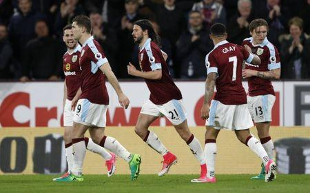 Burnley's George Boyd celebrates scoring their first goal with teammates
