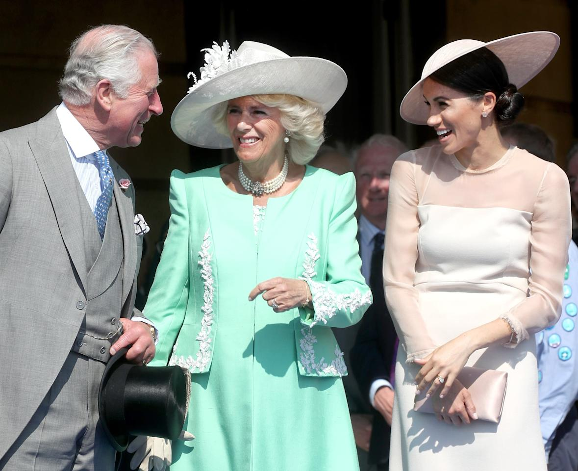 <p>Charles and Meghan shared a laugh with Camilla at his 70th birthday celebrations in May 2018.</p>
