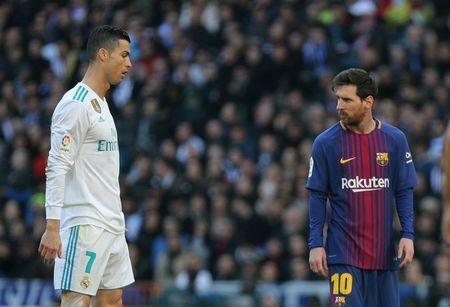 Soccer Football - La Liga Santander - Real Madrid vs FC Barcelona - Santiago Bernabeu, Madrid, Spain - December 23, 2017. Barcelona's Lionel Messi alongside Real Madrid's Cristiano Ronaldo. REUTERS/Sergio Perez/Files
