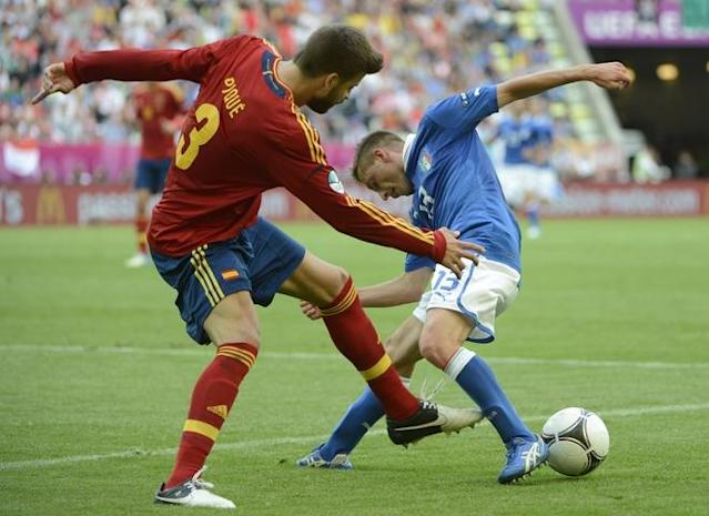 Spanish defender Gerard Pique (L) fights for the ball with Italian midfielder Emanuele Giaccherini during the Euro 2012 championships football match Spain vs Italy on June 10, 2012 at the Gdansk Arena. AFP PHOTO / PIERRE-PHILIPPE MARCOUPIERRE-PHILIPPE MARCOU/AFP/GettyImages