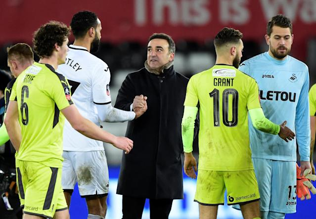 Soccer Football - FA Cup Fourth Round Replay - Swansea City vs Notts County - Liberty Stadium, Swansea, Britain - February 6, 2018 Swansea City manager Carlos Carvalhal celebrates after the match REUTERS/Rebecca Naden