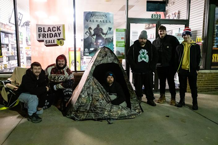 A group of Black Friday shoppers wait outside GameStop in Fort Gratiot for the store to open Friday, Nov. 27, 2020. Most of the group had been waiting outside the store since Wednesday for a new Xbox Series X or PlayStation 5.