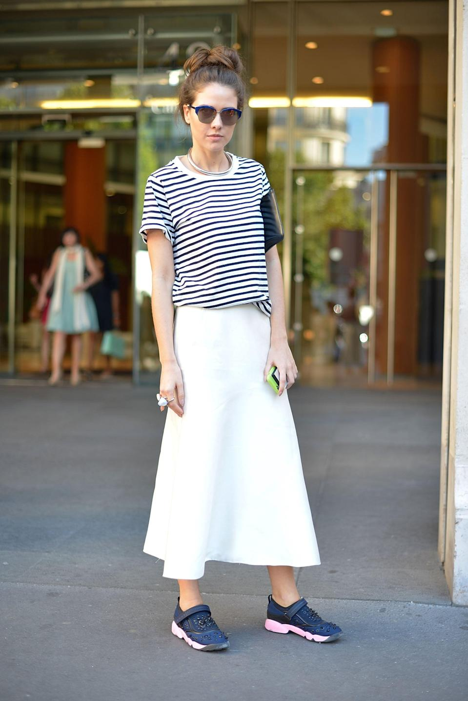 <p>A maxi skirt adds a sophisticated feel to a casual tee and sneakers.</p>