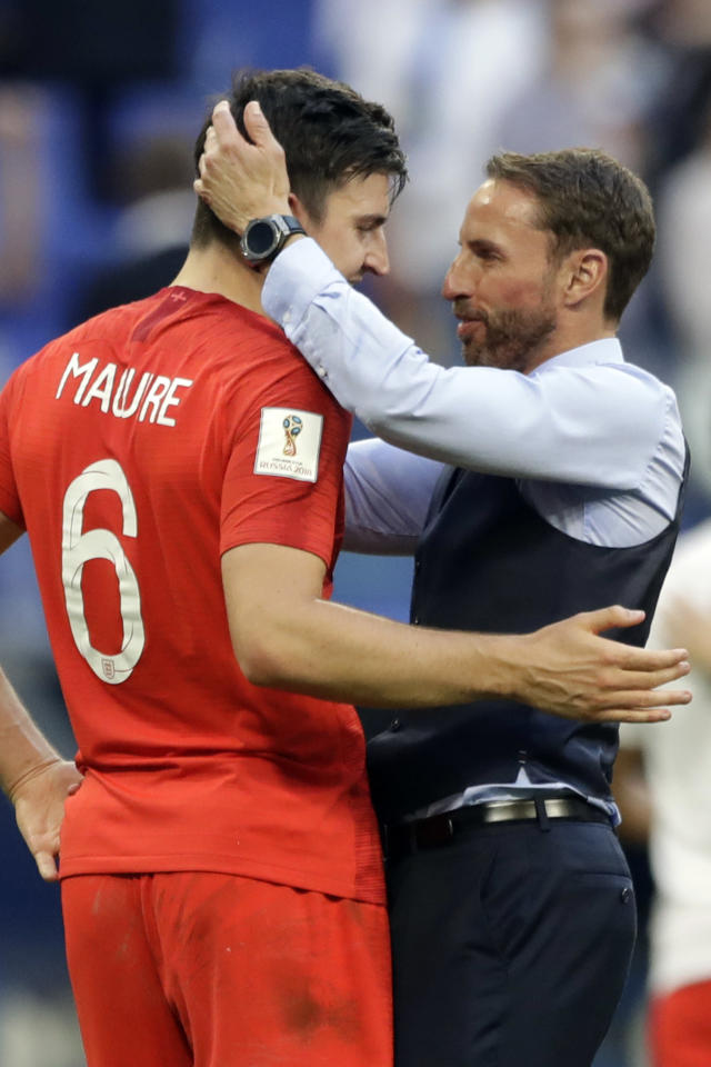 <p>England boss Gareth Southgate, right, celebrates Harry Maguire </p>