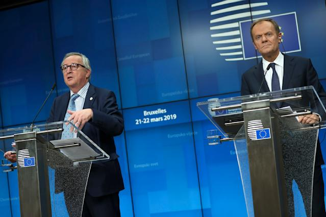 European Council President Donald Tusk, right, and European Commission President Jean-Claude Juncker participate in a media conference at the conclusion of an EU summit in Brussels, Friday, March 22, 2019. European Union leaders gathered again Friday after deciding that the political crisis in Britain over Brexit poses too great a threat and that action is needed to protect the smooth running of the world's biggest trading bloc. (AP Photo/Francisco Seco)