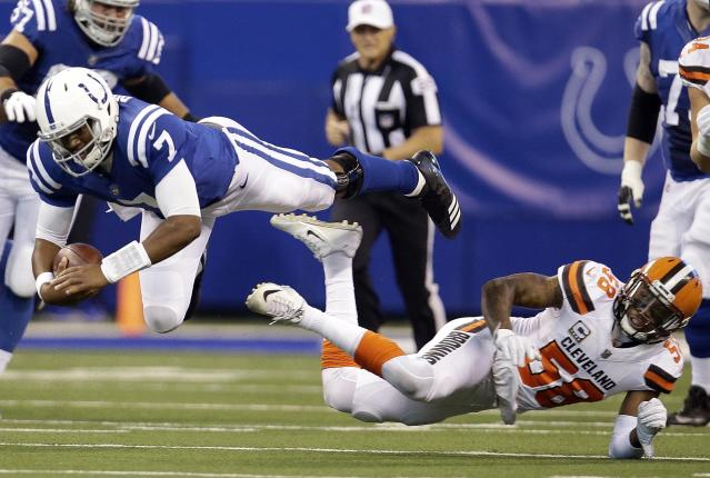<p>Indianapolis Colts quarterback Jacoby Brissett (7) dives over Cleveland Browns outside linebacker Christian Kirksey (58) during the first half of an NFL football game in Indianapolis, Sunday, Sept. 24, 2017. (AP Photo/AJ Mast) </p>