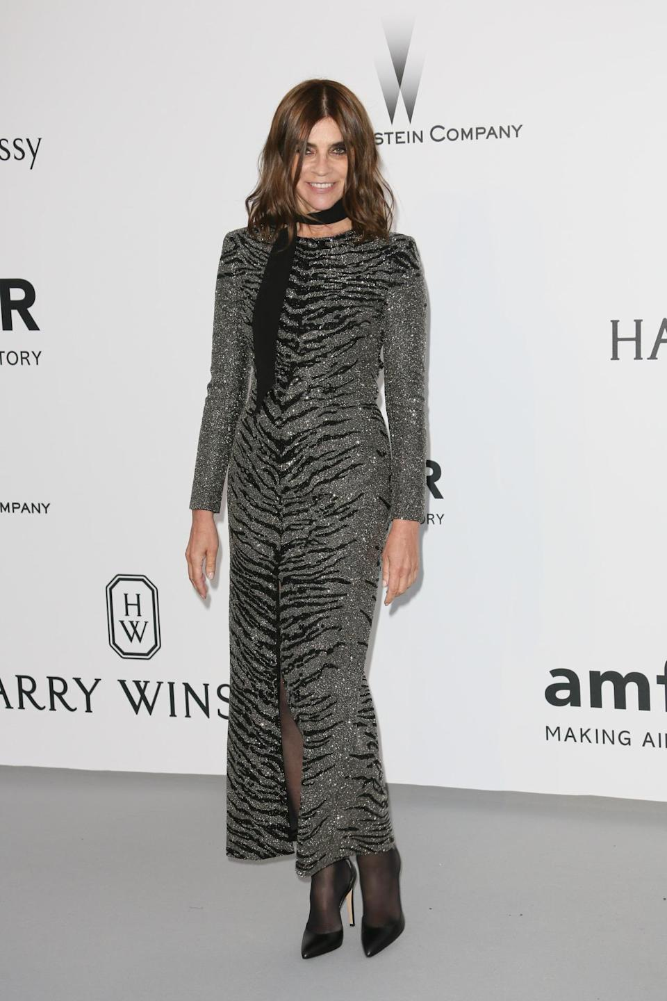<p>We're fairly certain that Carine Roitfeld is the only woman in the world who's capable of wearing a glittery, body-con, zebra-print dress—and still looking like the classiest broad on the block. The editrix keeps things cool in the busy print by accessorizing with slept-in hair (and makeup—a Carine staple), plus a simple black scarf tied around her neck. Rawr… or in this case… neigh? What sounds do zebras make, anyway? </p><p><i>Photo: Getty Images</i></p>
