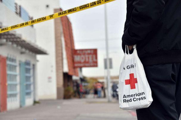 PHOTO: A displaced resident carries a bag from the Red Cross after a fire at a three-story apartment complex, Dec. 21, 2019 in Las Vegas. (David Becker/AP)