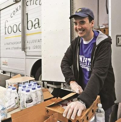 A Knight of Columbus in Connecticut assists with a food bank delivery