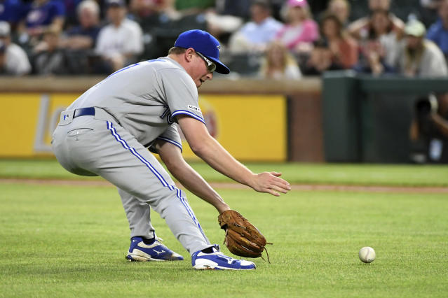 Toronto Blue Jays starting pitcher Trent Thornton fields a bunt by Texas Rangers' Jeff Mathis during the third inning of a baseball game Friday, May 3, 2019, in Arlington, Texas. Mathis was thrown out on the play. (AP Photo/Jeffrey McWhorter)