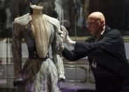 Curator Michael Wohlfart prepares former Austrian empress Elisabeth's blue Corfu gown, worn on Habsburg vacations to the Greek island, for exhibition at Sisi museum in Vienna April 22, 2014. REUTERS/Heinz-Peter Bader