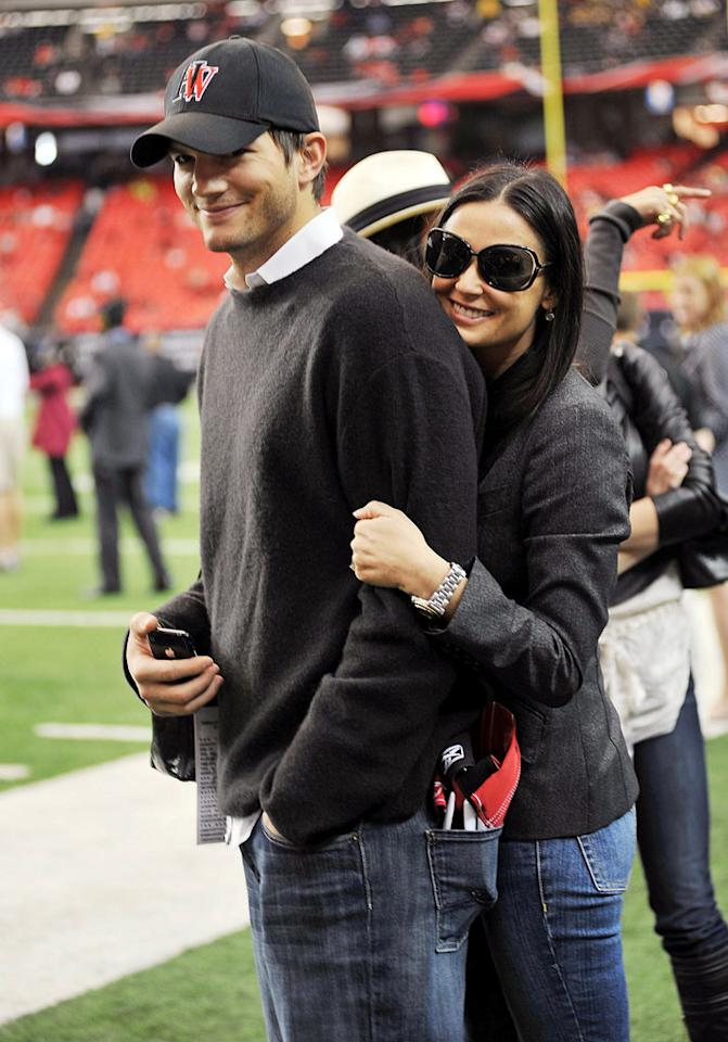 """<i>OK!</i> magazine reports Demi Moore and Ashton Kutcher don't just exercise together -- they do it in the nude! """"Ashton and Demi keep their marriage hot by motivating each other to stay in shape,"""" a source tells the tabloid, and that includes """"their own naked workout parties."""" Naked?! An insider bares all to <a href=""""http://www.gossipcop.com/demi-moore-naked-ashton-kutcher-nude/"""" target=""""new"""">Gossip Cop</a>. Moses Robinson/<a href=""""http://www.wireimage.com"""" target=""""new"""">WireImage.com</a> - November 9, 2008"""