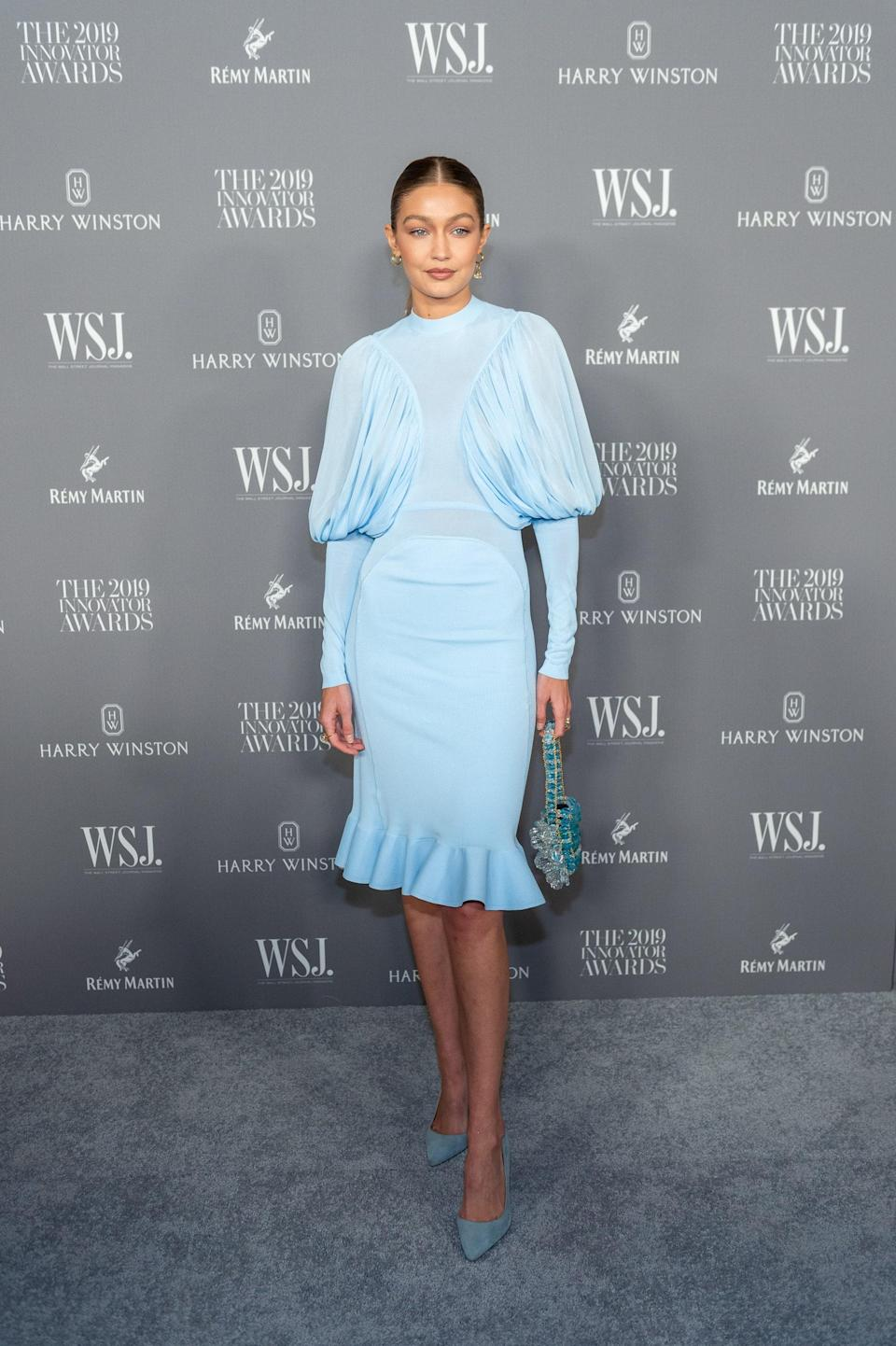 Gigi attended the WSJ Mag 2019 Innovator Awards at The Museum of Modern Art in this baby blue dress by Burberry.