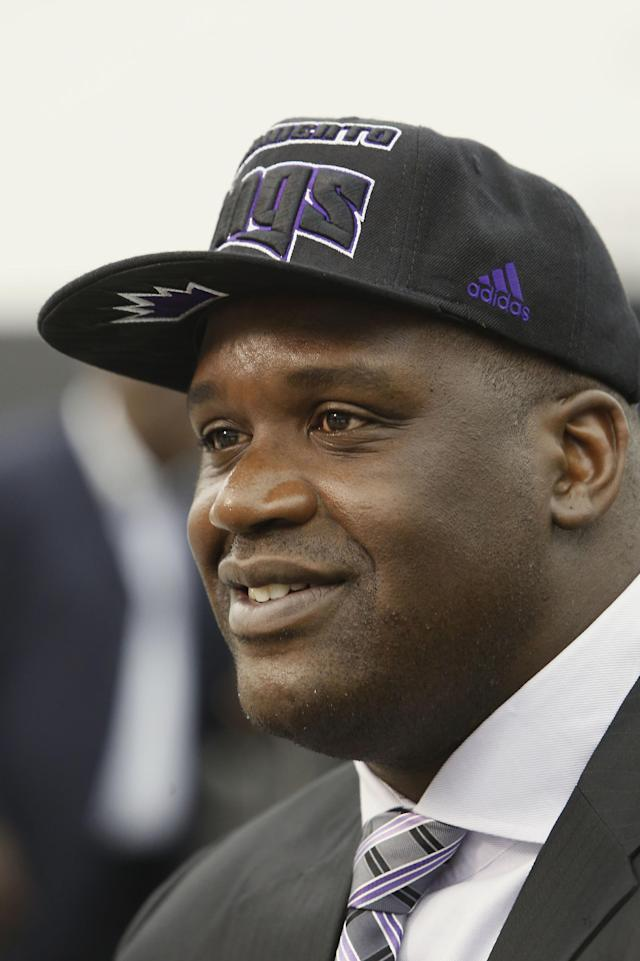Shaquille O'Neal talks to reporters after a news conference where he was welcomed as one of the new minority owners of the Sacramento Kings in Sacramento, Calif., Tuesday, Sept. 24, 2013. (AP Photo/Rich Pedroncelli)