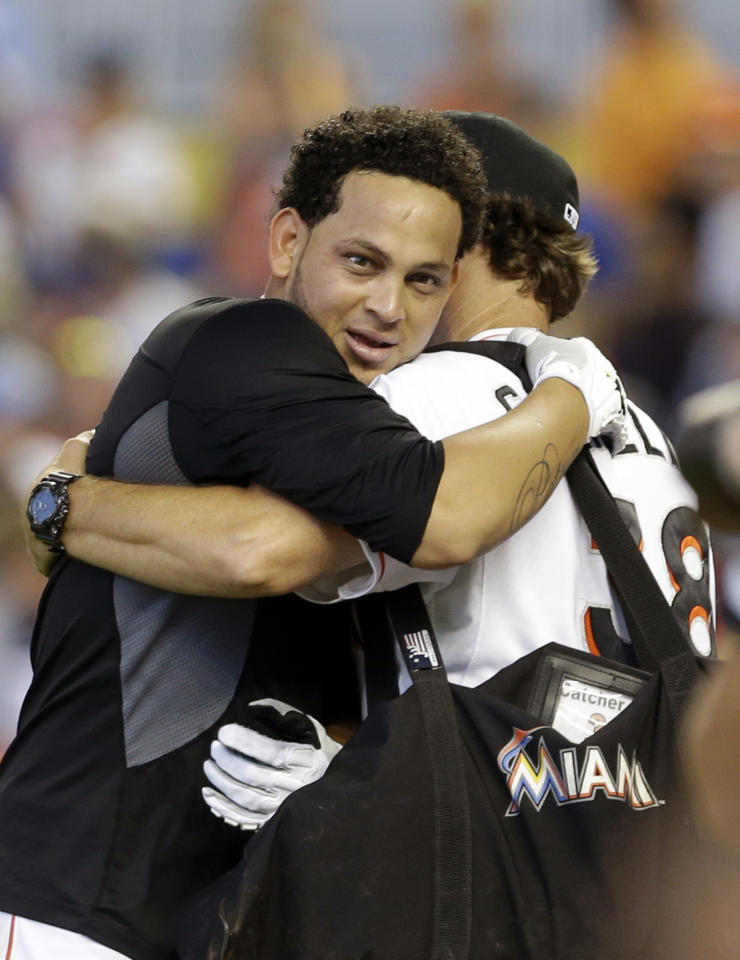 Miami Marlins' Henderson Alvarez, left, is hugged by bullpen coach Reid Cornelius (38) after pitching a no-hitter against the Detroit Tigers in an interleague baseball game on Sunday, Sept. 29, 2013, in Miami. The Marlins won 1-0. (AP Photo/Alan Diaz)