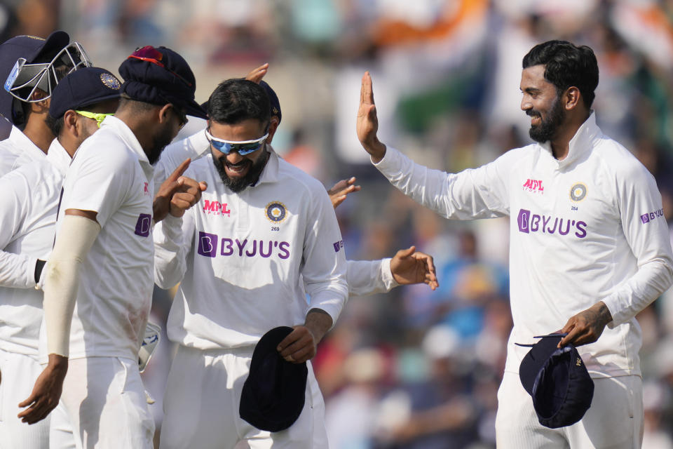 India's captain Virat Kohli , centre, celebrates with his players the taking of the wicket of England's Chris Woakes on day five of the fourth Test match at The Oval cricket ground in London, Monday, Sept. 6, 2021. (AP Photo/Kirsty Wigglesworth)